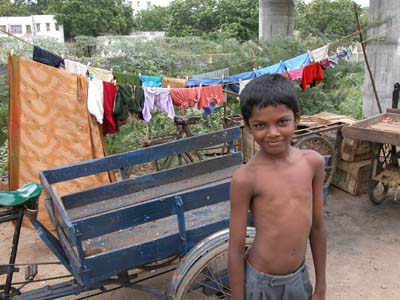 Boy_in_front_of_clothesline