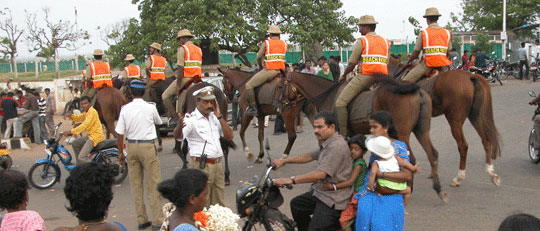 Policemen on horseback, Marina Beach, Chennai, India