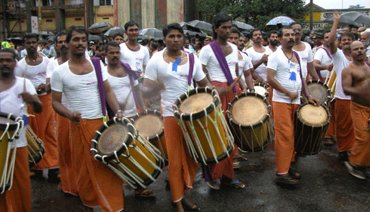 Drummers at Pulikkali festival in Thrissur, India