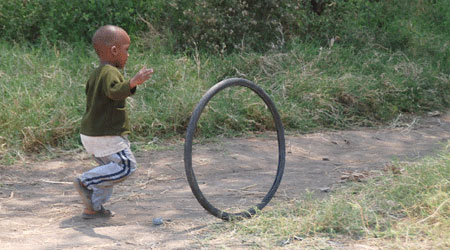 Tanzanian boy with tire